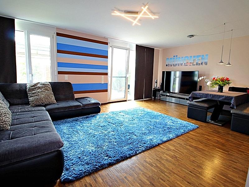 Neuwertiges REH mit großem Grundstück und unverbaubarem Blick in familienfreundlicher Lage von Höhenkirchen - Wohnzimmer1