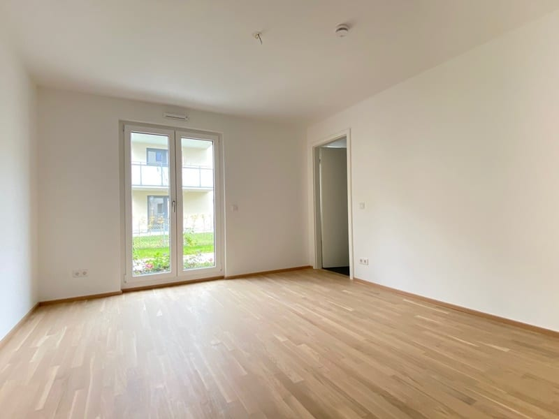 Erstbezug - Attraktive 3 ZKB Gartenwohnung mit 2 Bädern und EBK in Höhenkirchen - Schlafzimmer