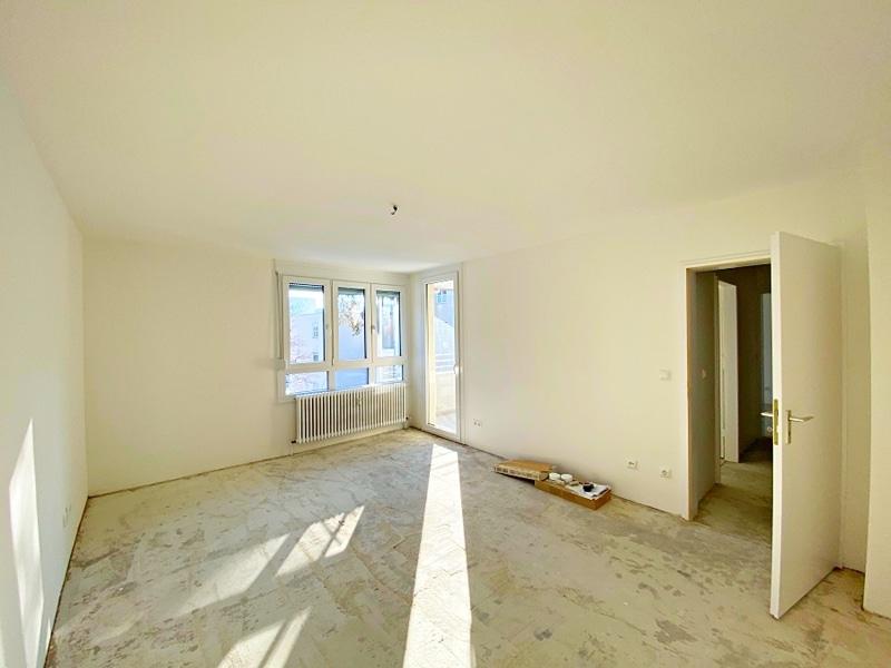 Lichtdurchflutete 2 Zimmerwohnung mit Südbalkon & attraktivem Grundriss in ruhiger Lage von Ottobrunn - Wohnzimmer