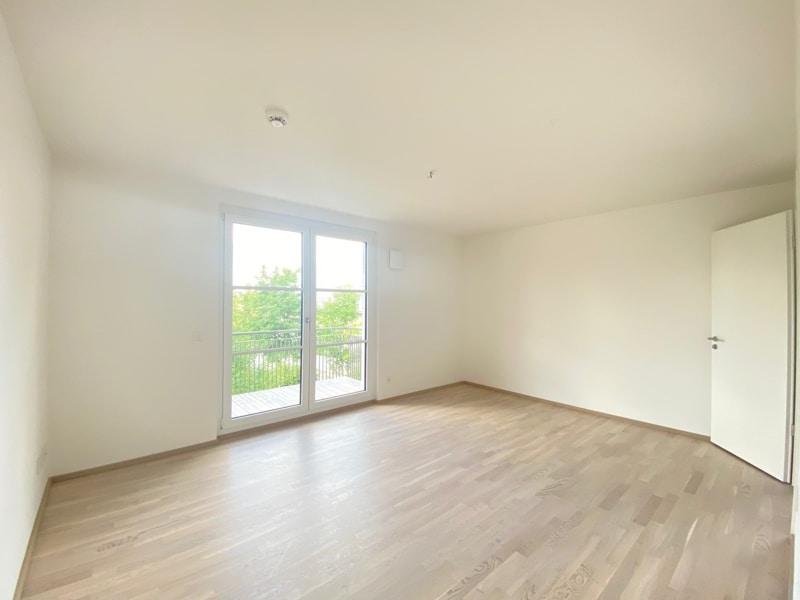 Erstbezug: Nach Westen ausgerichtete ruhige 4 Zimmerwohnung mit 2 Bädern und großem Balkon in der Ortsmitte von Höhenkirchen - Schlafzimmer