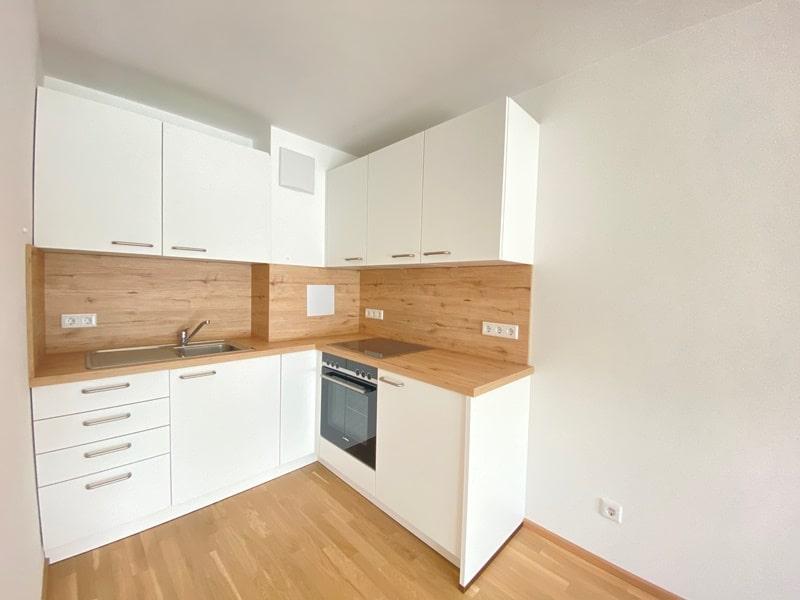 Neuwertige 2 ZKB Wohnung mit Westbalkon in zentraler Lage von Höhenkirchen-Siegertsbrunn - Küche
