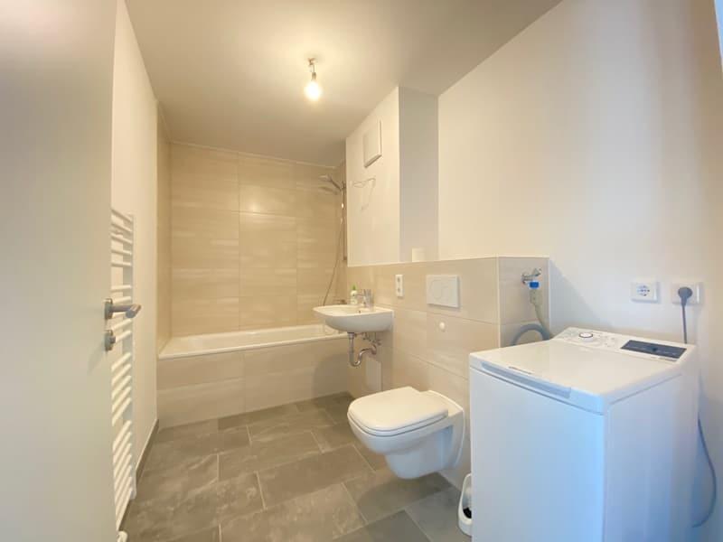 Neuwertige 2 ZKB Wohnung mit Westbalkon in zentraler Lage von Höhenkirchen-Siegertsbrunn - Badezimmer